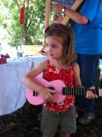 Young ukulele player at the High Strung Petting Zoo.